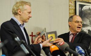 Elmer (right) and the symbolic handover