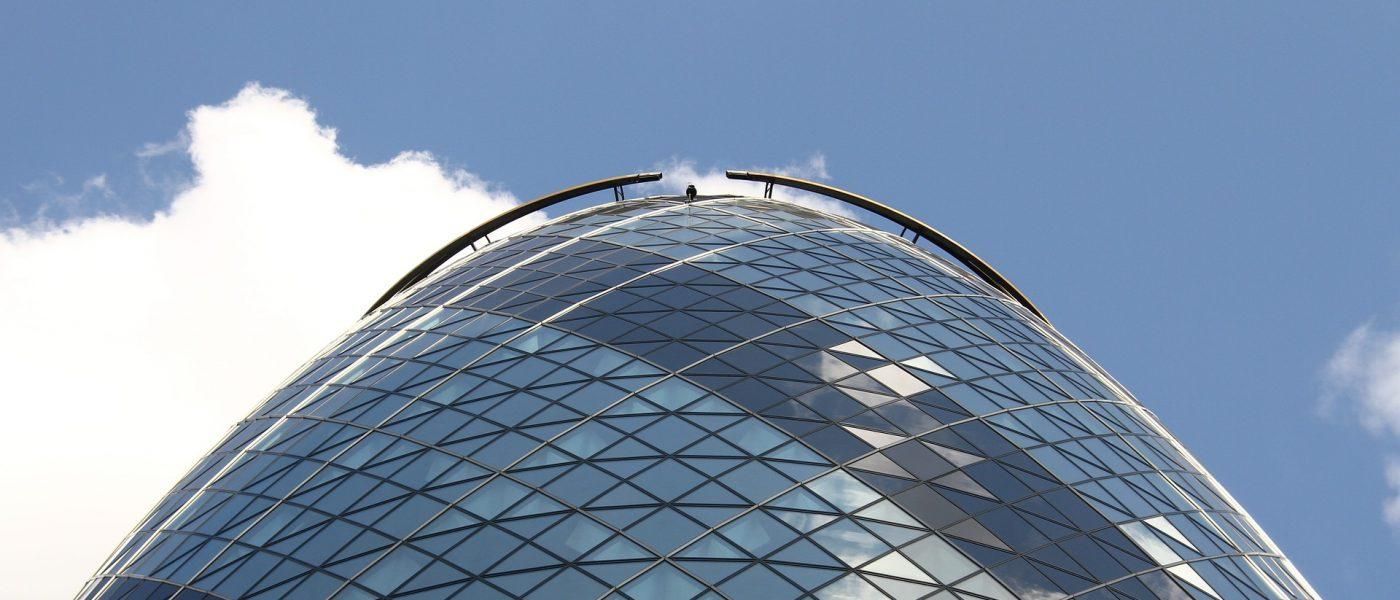 The Gherkin building, bright blue sky